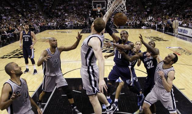 Memphis Grizzlies' Mike Conley (11) is defended by San Antonio Spurs' Matt Bonner, center, as he tries to score during the first half in Game 1 of a Western Conference Finals NBA basketball playoff series Sunday, May 19, 2013, in San Antonio. (AP Photo/Eric Gay)