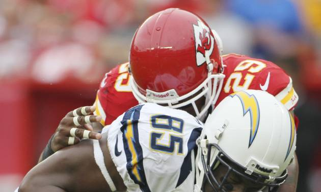 San Diego Chargers tight end Antonio Gates (85) is tackled by Kansas City Chiefs strong safety Eric Berry (29) during the first half of an NFL football game at Arrowhead Stadium in Kansas City, Mo., Sunday, Sept. 30, 2012. (AP Photo/Colin E. Braley)