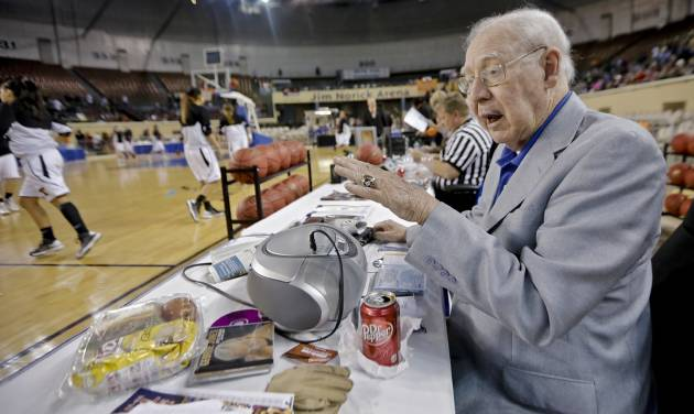 Former legendary girls basketball coach at Lindsay High School Charlie Heatly works his boom box as he controls the music during the Class 2A girls high school basketball semi-final  game between Preston and Tonkawa at the State Fair Arena in Oklahoma City, Okla. on Friday, March 14, 2014. This will be Heatly's the last of his 24 years controlling the music played during the state high school basketball championships.  Photo by Chris Landsberger, The Oklahoman