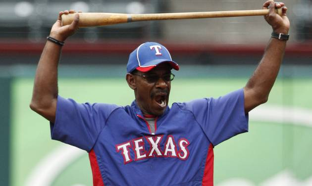 Texas Rangers manager Ron Washington (38) stretches as he stands in the infield during batting practice before a baseball game against the Seattle Mariners Saturday, Sept. 15, 2012, in Arlington, Texas. (AP Photo/Tony Gutierrez)