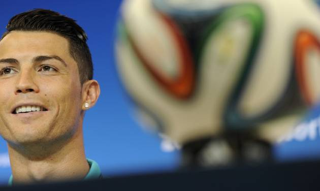 Portugal's Cristiano Ronaldo attends a news conference the day before the group G World Cup soccer match between Germany and Portugal at the Arena Fonte Nova in Salvador, Brazil, Sunday, June 15, 2014.  (AP Photo/Paulo Duarte)