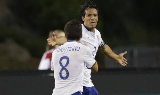 Portugal defender Bruno Alves is congratulated by teammatre Joao Moutinho, left, after his goal during the second half of their friendly soccer match against Mexico in Foxborough, Mass., Friday, June 6, 2014.  Portugal won 1-0. (AP Photo/Charles Krupa)