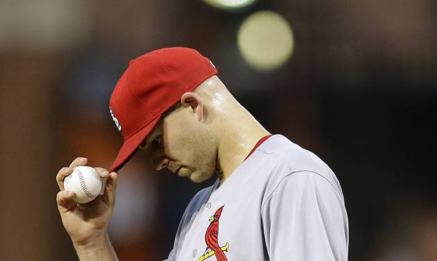 St. Louis Cardinals starting pitcher Justin Masterson pauses in the third inning of an interleague baseball game against the Baltimore Orioles, Friday, Aug. 8, 2014, in Baltimore. Masterson was removed in the third inning. (AP Photo/Patrick Semansky)