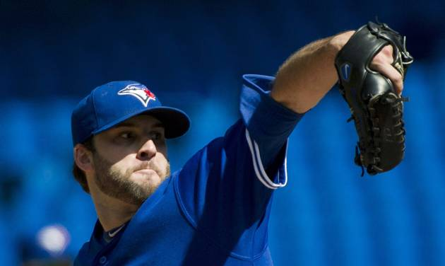 Toronto Blue Jays starting pitcher Brandon Morrow works against the Boston Red Sox during the first inning of a baseball game in Toronto on Sunday, Sept. 16, 2012. (AP Photo/The Canadian Press, Nathan Denette)