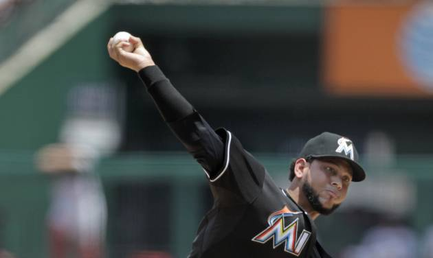 Miami Marlins starting pitcher Henderson Alvarez delivers a pitch in the first inning of a baseball game against the St. Louis Cardinals, Sunday, July 6, 2014 in St. Louis. (AP Photo/Tom Gannam)