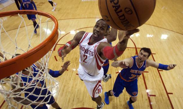 Houston Rockets center Dwight Howard (12) lays the ball up during the first quarter of an NBA basketball game against the New York Knicks, Friday, Jan. 3, 2014, in Houston. (AP Photo/Patric Schneider)