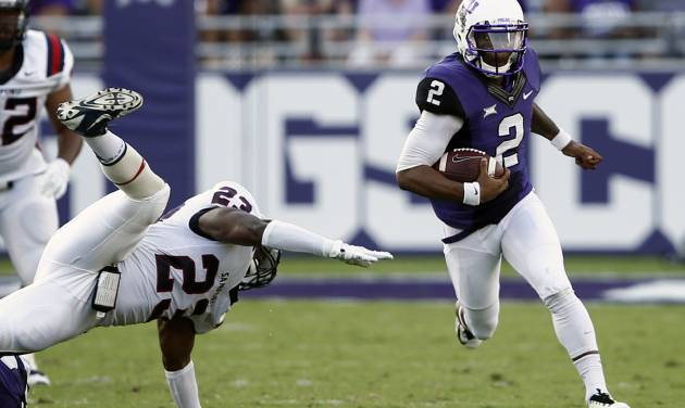 TCU quarterback Trevone Boykin (2) rushes past Samford linebacker Justin Cooper (23) in the first half of an NCAA college football game in Fort Worth, Texas, Saturday, Aug. 30, 2014. (AP Photo/Jim Cowsert)