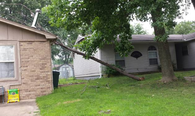 Heavy winds toppled a weakened tree limb onto the roof of The Oklahoman's Sheila Stogsdill, who learned that her insurance policy was liable for covering the damage. PHOTO BY SHEILA STOGSDILL, FOR THE OKLAHOMAN