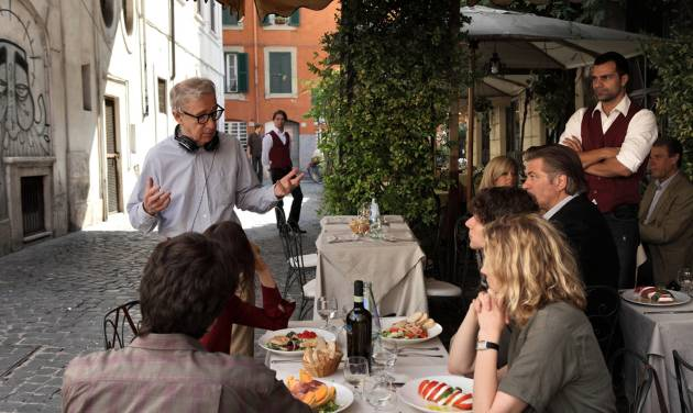 "This film image released by Sony Pictures Classics shows director Woody Allen, standing left, talking with the cast during the filming of ""To Rome With Love."" ""To Rome With Love"" is Woody Allen's 45th film, a total the 76-year-old director has amassed by making, with remarkable consistency, a film a year. (AP Photo/Sony Pictures Classics, Philippe Antonello)"