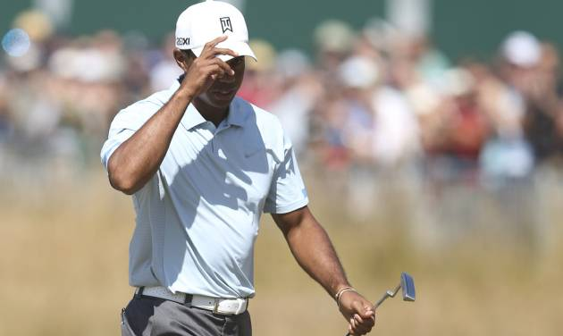 Tiger Woods of the United States acknowledges the crowd on the 18th green after his second round of the British Open Golf Championship at Muirfield, Scotland, Friday July 19, 2013. (AP Photo/Scott Heppell)