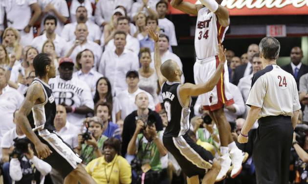 FILE - In this June 19, 2013 file photo, Miami Heat shooting guard Ray Allen (34) shoots a three-point basket in the final seconds of regulation during the second half of Game 6 of the NBA Finals basketball game against the San Antonio Spurs, in Miami. Allen's shot sent the game into overtime. For Ray Allen, it was The Summer of The Shot. Everywhere he went, all anyone wanted to talk to him about was the 3-pointer with 5.2 seconds left in Game 6 of the NBA Finals, the one that saved the Miami Heat title chances. And Allen didn't mind one bit, but even he says it's time to get ready for a new year. (AP Photo/Lynne Sladky, File)