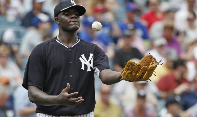 New York Yankees starting pitcher Michael Pineda tosses the ball after allowing a run to score on a wild pitch in the fifth inning of a 3-1 loss to the Toronto Blue Jays in a spring exhibition baseball game in Tampa, Fla., Sunday, March 23, 2014. (AP Photo/Kathy Willens)