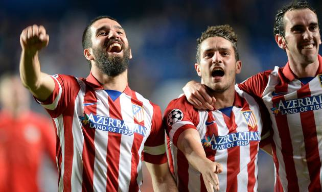 Atletico Madrid's Arda Turan, left, Koke, center, and Diego Godin celebrate after the Champions League semifinal second leg soccer match between Chelsea and Atletico Madrid at Stamford Bridge Stadium in London, Wednesday, April 30, 2014. (AP Photo/Andrew Matthews, PA Wire)    UNITED KINGDOM OUT   -   NO SALES   -  NO ARCHIVES