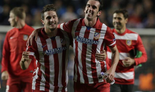 Atletico's Koke, left and teammate Atletico's Diego Godin celebrate in front of their fans after defeating Chelsea in the Champions League semifinal second leg soccer match between Chelsea and Atletico Madrid at Stamford Bridge stadium in London, Wednesday, April 30, 2014. (AP Photo/Matt Dunham)