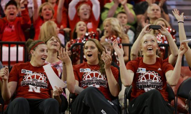 CORRECTS THE ROUND THE TEAM WILL PLAY IN - Nebraska's Jordan Hooper, left, Hailie Sample, center, and   Emily Cady, right, react after they hear their assignment for the NCAA college basketball tournament during a live television broadcast in Lincoln, Neb., Monday, March 17, 2014. Nebraska will play in the first round against Fresno State in Los Angeles.  (AP Photo/Nati Harnik)
