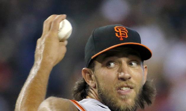 San Francisco Giants pitcher Madison Bumgarner throws against the Arizona Diamondbacks during the second inning of a baseball game on Sunday, June 22, 2014, in Phoenix. (AP Photo/Matt York)