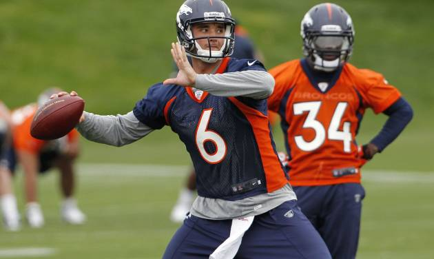 Rookie quarterback Brock Osweiler (6) sets to throw a pass during the Denver Broncos NFL football rookie minicamp at the team's training facility in Englewood, Colo., on Friday, May 11, 2012. Running back Ronnie Hillman (34) looks on at right. (AP Photo/Ed Andrieski)