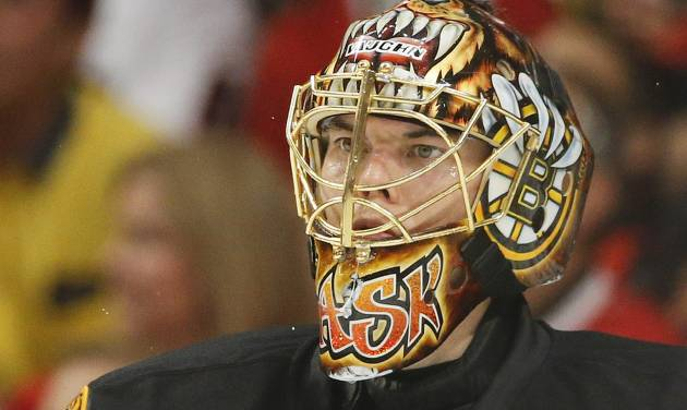 Boston Bruins goalie Tuukka Rask (40) reacts as he watches play down the ice against the Chicago Blackhawks in the third period during Game 2 of the NHL hockey Stanley Cup Finals, Saturday, June 15, 2013, in Chicago. (AP Photo/Nam Y. Huh)