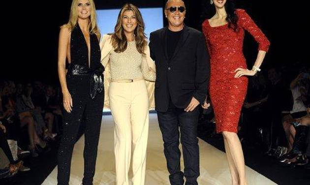 Project Runway judges, left to right, Heidi Klum, Nina Garcia, Michael Kors, and Lauren Scott pose before finalists show their designs Friday, Sept. 9, 2011, during Fashion Week in New York.   (AP Photo/ Louis Lanzano)