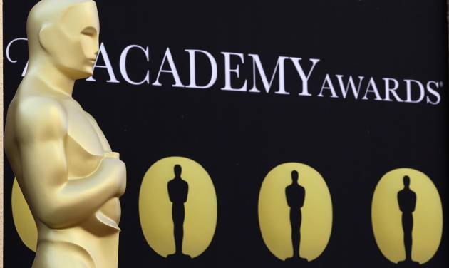 FILE - In this March 5, 2010 file photo, an Oscar statue stands on the red carpet outside the 82nd Academy Awards in Los Angeles. The 85th annual Academy Awards will be held on Sunday, Feb. 24, 2013.  (AP Photo/Amy Sancetta, file)