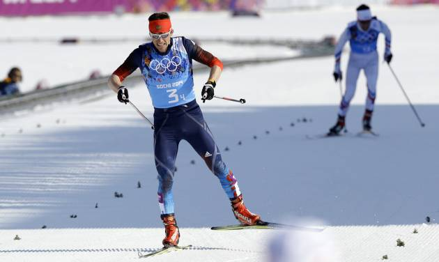 Russia's Maxim Vylegzhanin approaches the finish line to win the silver medal in the men's 4x10K cross-country relay at the 2014 Winter Olympics, Sunday, Feb. 16, 2014, in Krasnaya Polyana, Russia. (AP Photo/Kirsty Wigglesworth)