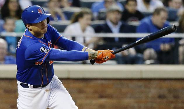 New York Mets' Wilmer Flores follows through on a two-run single during the second inning of a baseball game against the Chicago Cubs, Saturday, Aug. 16, 2014, in New York. (AP Photo/Frank Franklin II)