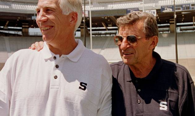 FILE - In this Aug. 6, 1999 file photo, Penn State head football coach Joe Paterno, right, poses with his defensive coordinator Jerry Sandusky during Penn State Media Day at State College, Pa.  A lawsuit by Joe Paterno's family and others against the NCAA is scheduled to go to court Wednesday, Oct. 30, 2013, one day after Penn State announced settlements with 26 young men over claims of abuse by Jerry Sandusky. (AP Photo/Paul Vathis, File)