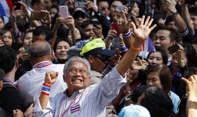 Anti-government protest leader Suthep Thaugsuban waves to supporters during a march through the streets of central Bangkok, Thailand, Tuesday, Jan. 21, 2014.  Thailand has declared a state of emergency in Bangkok and its surrounding areas to cope with anti-government protests that have stirred up violent attacks. (AP Photo/Wally Santana)