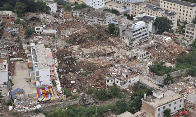 This aerial photo shows buildings toppled down by a 6.5-magnitude earthquake at the quake's epicenter in the town of Longtoushan in Ludian County of Zhaotong, southwest China's Yunnan Province, Monday, Aug. 4, 2014. Rescuers dug through shattered homes Monday looking for survivors of the strong earthquake in southern China as the death toll rose to hundreds of people, with more than 1,800 injured. (AP Photo/Xinhua, Xue Yubin) NO SALES