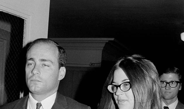 """FILE - In this Sept. 23, 1970 file photo, Barbara Hoyt, 19, former member of Charles Manson's hippie """"family"""" arrives at court to testify as a prosecution witness in the Tate-La Bianca murder trial in Los Angeles. On Aug. 9, 1969, two naive 17-year-olds were launched on a path toward the most unlikely of friendships. That infamous night four young people under the sway of a charismatic career criminal slipped into a home in a neighborhood of Hollywood glitterati, then bludgeoned and stabbed rising young actress Sharon Tate, her friend and coffee heiress Abigail Folger, and two others. (AP Photo/Wally Fong, File)"""