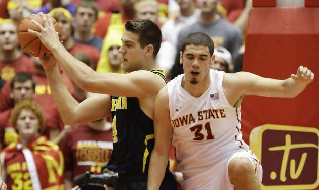 Michigan forward Mitch McGary, left, grabs a rebound in front of Iowa State forward Georges Niang during the first half of an NCAA college basketball game on Sunday, Nov. 17, 2013, in Ames, Iowa. (AP Photo/Charlie Neibergall)