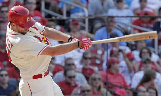 St. Louis Cardinals starting pitcher Adam Wainwright connects for a double in the fifth inning of a baseball game against the Philadelphia Phillies, Saturday, June 21, 2014, in St. Louis. (AP Photo/Tom Gannam)