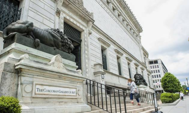 FILE - This May, 2014 file photo shows the entrance of the Corcoran Gallery of Art in Washington.  Nine current students, faculty and staff members can argue against the proposed merger of the Corcoran Gallery of Art, one of the nation's oldest museums, and its college with two larger institutions in Washington, a judge ruled Monday.   (AP Photo/Kevin Wolf)