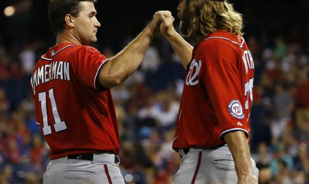 Washington Nationals' Ryan Zimmerman, left, and Jayson Werth celebrate after Zimmermann hit the go-ahead RBI-single in the 10th inning of a baseball game against the Philadelphia Phillies, Saturday, July 12, 2014, in Philadelphia. Washington won 5-3 in 10 innings. (AP Photo/Matt Slocum)