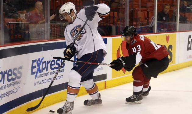 Justin Schultz of the Oklahoma City Barons tries to keep the puck away from Mike Sgarbossa of the Lake Erie Monsters during AHL hockey game at the Cox Convention Center in Oklahoma City, Tuesday, October 23, 2012. Photo by Bryan Terry, The Oklahoman