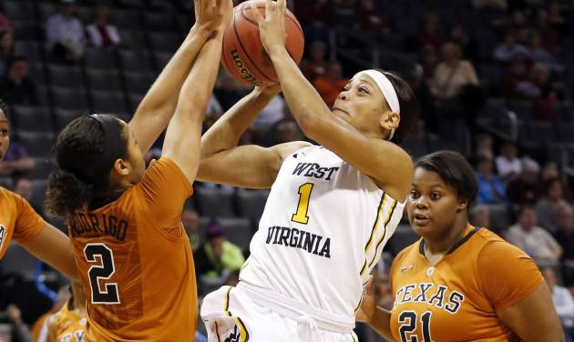 West Virginia guard Christal Caldwell (1) shoots between Texas guard Celina Rodrigo (2) and forward Nekia Jones (21) in the first half of an NCAA college basketball game in the semifinals of the Big 12 Conference women's college tournament in Oklahoma City, Sunday, March 9, 2014.(AP Photo/Sue Ogrocki)