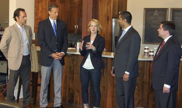 Karla Santi of Blend Interactive tells how her Web design and development company uses the Internet in Sioux Falls, S.D., on Thursday, May 29, 2014. Joining her from left are Michael Beckerman with The Internet Association, Sen. John Thune, and Federal Communications Commissioners Ajit Pai and Michael O'Rielly. (AP Photo/Carson Walker)