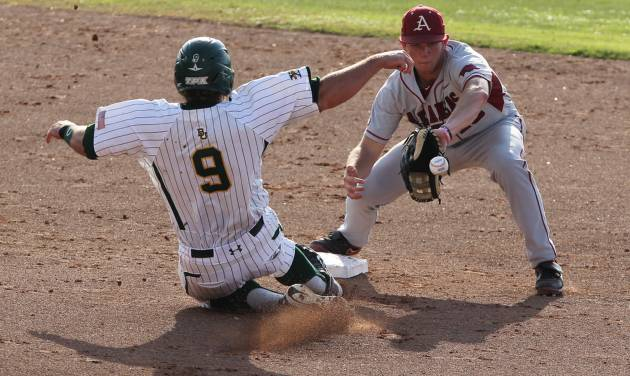 Arkansas' Tim Carver, right, tags out Baylor Max Muncy (9) in the second inning of an NCAA college baseball tournament super regional game, Monday, June 11, 2012, in Waco, Texas. (AP Photo/Waco Tribune Herald, Jerry Larson)