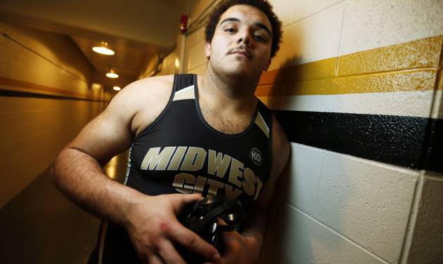 Midwest City's Carlos Freeman poses for a photo during the 6A West wrestling regional at Midwest City High School in Midwest City, Okla., Friday, Feb. 15, 2013. Photo by Nate Billings, The Oklahoman