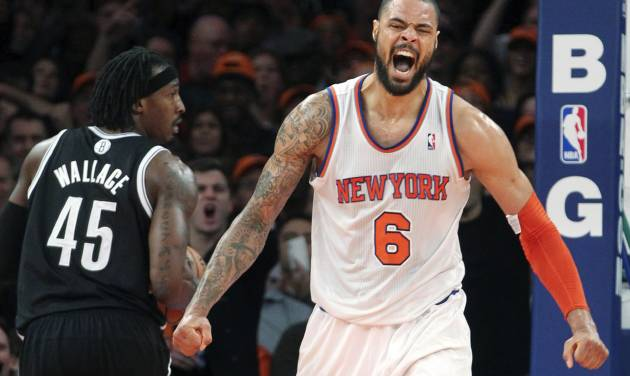 Brooklyn Nets' Gerald Wallace (45) watches as New York Knicks' Tyson Chandler (6) reacts after dunking during the second half of an NBA basketball game, Wednesday, Dec. 19, 2012, at Madison Square Garden in New York. The Knicks won 100-86. (AP Photo/Mary Altaffer)