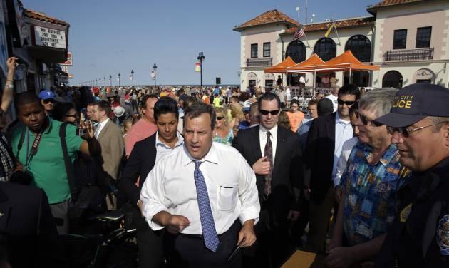 FILE - In this Thursday, Aug. 14, 2014, file photo, New Jersey Gov. Chris Christie walks along a boardwalk after a town hall meeting in Ocean City, N.J. Christie is heading to Mexico officially for a trade mission typical of any governor. But Christie is a potential GOP presidential candidate with little foreign policy expertise, a lot of swagger and much to learn about international diplomacy. He is one of several potential White House hopefuls burnishing their foreign policy credentials for any possible general election matchup against Democrat Hillary Rodham Clinton, a former secretary of state. (AP Photo/Mel Evans, File)
