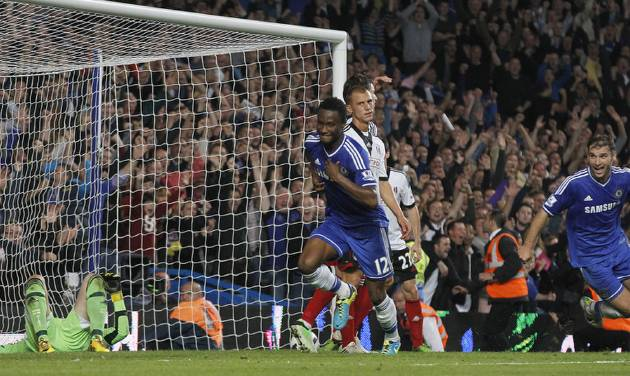Chelsea's Mikel, centre, runs as he celebrates after scoring a goal against Fulham during the English Premier League soccer match between Chelsea and Fulham at Stamford Bridge, London, Saturday, Sept. 21, 2013. (AP Photo/Sang Tan)