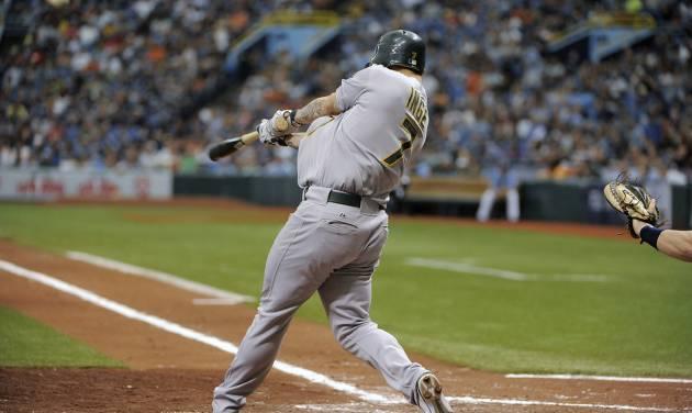 Oakland Athletics' Brandon Inge swings on a three-run home run off of Tampa Bay Rays starting pitcher Matt Moore during the third inning of a baseball game Sunday, May 6, 2012, in St. Petersburg, Fla. (AP Photo/Brian Blanco)