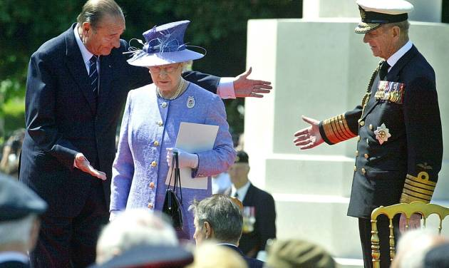FILE - In this June 6, 2004 file photo, French President Jacques Chirac, left, greets Queen Elizabeth II, of Britain, and her husband Prince Philip at the British military cemetery in Bayeux, northwestern France, during ceremonies marking the 60th anniversary of the D-Day landings in Normandy. The perils of World War II directly shaped the lives of Elizabeth, 88, and Philip, 92. The anniversary is so heartfelt that the royal couple is preparing to cross the English Channel once more, this time on a Eurostar train through the Channel Tunnel Elizabeth helped 20 years ago. (AP Photo/Michel Spingler, File)