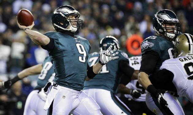 Philadelphia Eagles' Nick Foles drops back during the first half of an NFL wild-card playoff football game against the New Orleans Saints, Saturday, Jan. 4, 2014, in Philadelphia. (AP Photo/Matt Rourke)