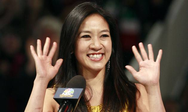 FILE - In this Jan. 28, 2012 file photo, former figure skater Michelle Kwan waves at an on-ice recognition for her Hall of Fame induction at the U.S. Figure Skating Championships in San Jose, Calif. Kwan is fitting in some time for political campaigning while she covers the Sochi Games. The two-time Olympic figure skating medalist is asking notable names to pose for a photo holding a pin supporting Clay Pell for governor of Rhode Island. Her husband announced Jan. 27, 2014, that he is running for the state's top office. (AP Photo/Jeff Chiu, File)