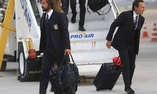 Italy's player Andrea Pirlo, left, and coach Cesare Prandelli deplane at Galeao Air Base as they arrive for the World Cup in Rio de Janeiro, Brazil, Friday, June 6, 2014. The Italian team will be based at a resort in Mangaratiba during the soccer international tournament.  (AP Photo/Leo Correa)