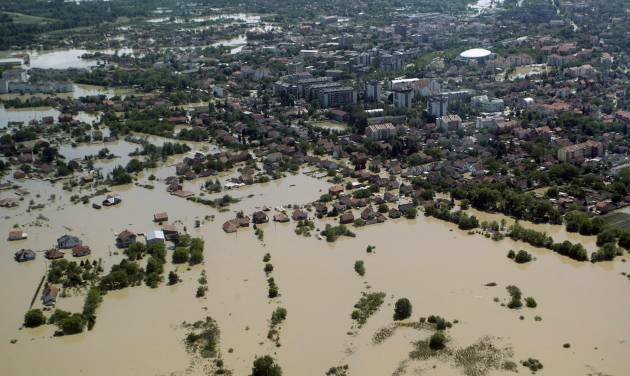 A flooded area is seen in Obrenovac, some 30 kilometers (18 miles) southwest of Belgrade, Serbia, Monday, May 19, 2014. Belgrade braced for a river surge Monday that threatened to inundate Serbia's main power plant and cause major power cuts in the crisis-stricken country as the Balkans struggle with the consequences of the worst flooding in southeastern Europe in more than a century. At least 35 people have died in Serbia and Bosnia in the five days of flooding caused by unprecedented torrential rain, laying waste to entire towns and villages and sending tens of thousands of people out of their homes, authorities said. (AP Photo)