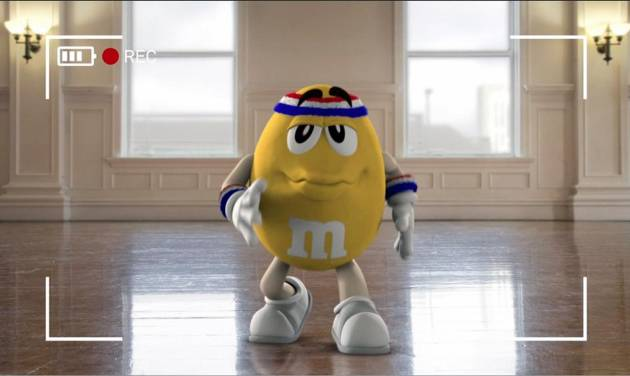 """This image provided by Mars Inc. shows an online teaser ad for M&M's Super Bowl ad featuring its yellow peanut M&M """"spokescandy"""". The teaser is part of a Super Bowl ad trend: More content is being released ahead of time online in the hope that it goes viral. Advertisers are seeking to drum up excitement for their spots running during the big game, when more than 108 million people are expected to watching Feb. 2. (AP Photo/Mars Inc.)"""