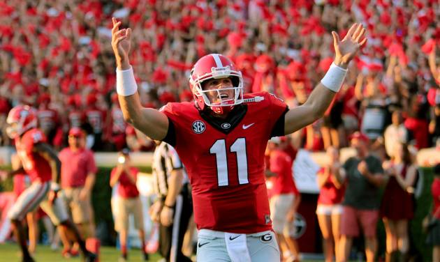 Georgia quarterback Aaron Murray celebrates his 85-yard touchdown throw to wide receiver Justin Scott-Wesley in the fourth quarter against South Carolina in an NCAA college football game Saturday, Sept. 7, 2013, in Athens, Ga. Georgia won 41-30. (AP Photo/Atlanta Journal Constitution, Jason Getz) GWINNETT OUT  MARIETTA OUT   LOCAL TV OUT (WXIA, WGCL, FOX 5)